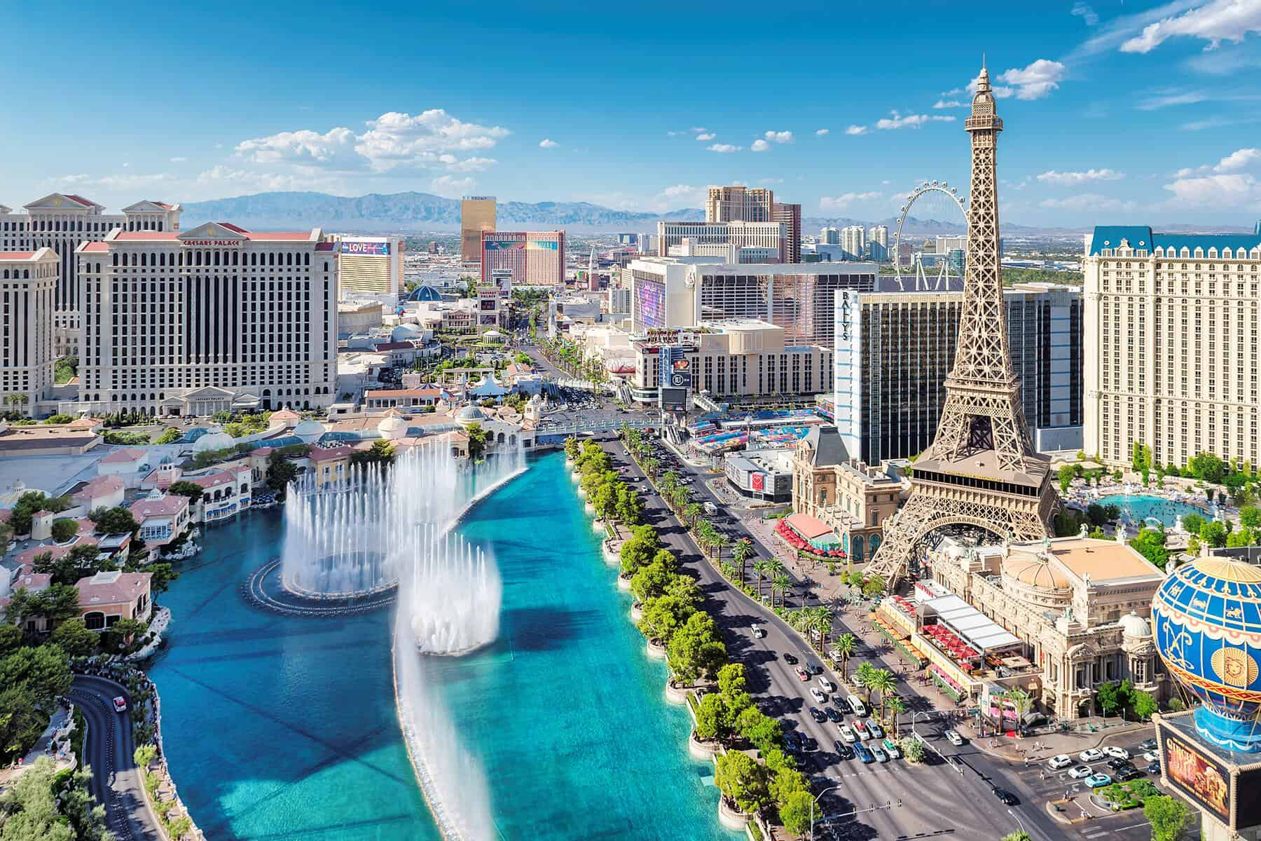 Las Vegas Strip with Bellagio Fountains and Paris Hotel on bright summer day